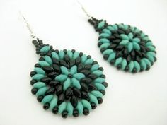 Beautiful beadwoven earrings! Made of Czech super duo beads in turquoise green and Japanese seed beads in black. Your choice of silver plated or