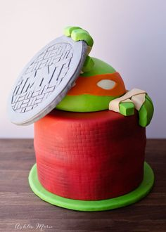 Teenage Mutant ninja turtle cake - climbing out of a sewer with a TMNT manhole cover