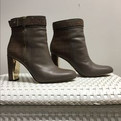 "ANN TAYLOR BOOTIES 💥💥chic booties in light brown/beige & Grey/beige color. This shoe is right on trend with gold buckle & zipper. Back of shoe & heel are crock leather. Inside of heel is gold as pictures.  No marks or scuffs on the shoes.  Heel measures approximately 31/2"".  Some scuffing on the soles as shown.  100% leather.  All offers will be considered💥💥 Ann Taylor Shoes Ankle Boots & Booties"