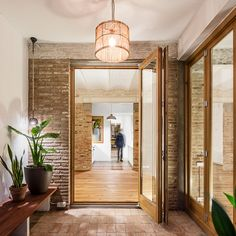 the new home acts as 'a gallery that connects the street with the inner courtyards' and preserves the material heritage of the former home.