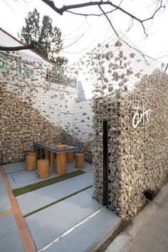 restaurant exterior Deconstructing the gabion wall. Cafe Ato by Design BONO, Seoul store design Landscape Architecture, Landscape Design, Architecture Design, Garden Design, Creative Landscape, Landscape Plans, Café Exterior, Design Exterior, Fence Landscaping