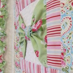 A feminine quilt featuring 3 dimensional bows and a sassy frilled edge. Follow the instructions for quilt as you go, or make the quilt top only. Complete the set with the cheeky bow shaped cushion.