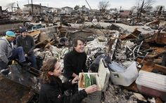 A couple discovering their family records survived Hurricane Sandy
