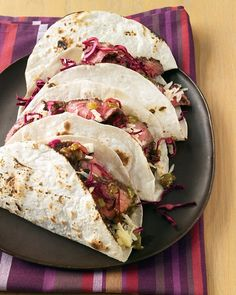 Flat-Iron Steak Tacos ....  Instead of ground beef, fill flour tortillas with tender steak and a quick cabbage slaw -- all ready in 20 minutes. Marinated cabbage salad makes a tangy partner for meaty tacos. A little lime juice is enough to soften the cabbage.
