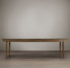 RH's Vintage French Fluted-Leg Extension Dining Table:Inspired by 19th-century French Empire design, our extension table promises to host gatherings for continued generations. Hand built of solid oak and fine veneers, it has a full skirt and slender legs. A weathered finish lends it the look  of graceful age.