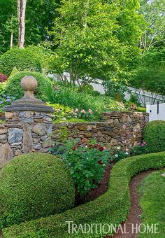 On the garden's lowest level, clipped boxwoods form a serpentine edging in front of a rose bed. - Photo: Rob Cardillo #formalgardens