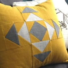 A new take on an traditional quilting pattern, this throw pillow cover is the perfect mix of modern and old school.