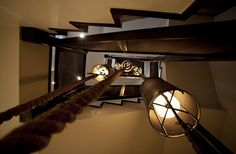 Here's a different perspective. Rope lighting fixtures dangling from top in a stairwell!