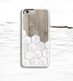 This patterned iPhone case has got your phone's back, and stylishly at that. Tiled white marble hexagons are layered over weathered wood, the design printed on an aluminum backing with a fade- and scratch-resistant glossy finish. The slim plastic case snaps onto your phone, with a small lip wrapping around the front to protect the screen when laid facedown.