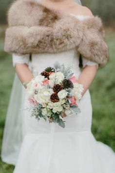 Whimsical winter bouquet: http://www.stylemepretty.com/2015/04/14/elegant-pacific-northwest-winter-wedding/ | Photography: Anna Jaye Photography - www.annajayephotography.com