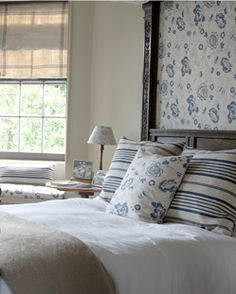 Use the same fabric as the pillows for an accent on a headboard, artwork, lampshade, etc