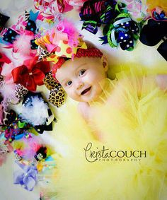 Bows!!!  What a cute picture idea.  I might have to save this for Ava's 1 year shoot with Brooke!!