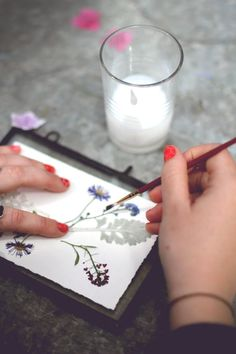 DIY Terrain | Free People Blog #freepeople - #5 - Secure the flowers on the paper by painting over them with matte medium and a bit of water. Allow to completely dry.