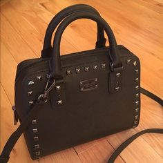 NEWMichael Kors Studded Saffiano Satchel NEWMichael Kors Studded Saffiano Satchel. Leather with gunmetal studs and hardware. Removable Crossbody strap for convenience. Rare to find!no trade  no hold no PayPal Michael Kors Bags Crossbody Bags