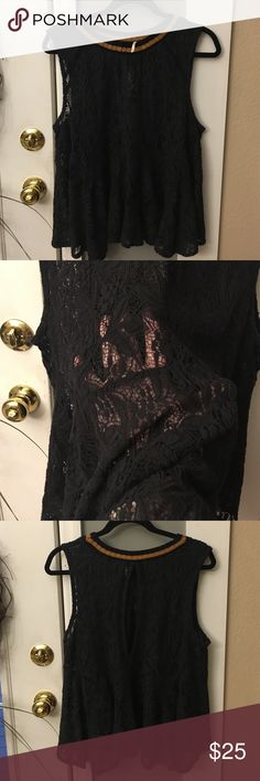 Free People Black Lace Top Excellent condition, worn only a couple of times. Black lace needs tank underneath. Pic of materials in photos. Black with tan color neck line. Women's sleeveless top. Flares out at bottom. Has peep hole on back for a cute touch. Measures approximately 25 inches in length. From arm pit to arm pit for bust measures approximately 21 inches. Authentic Free People Tops Blouses