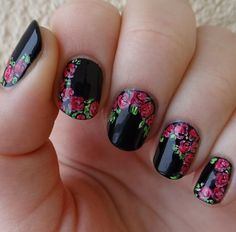 Floral nail design with black background