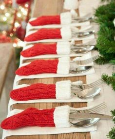 Christmas dinner silverware tucked into small Christmas stockings. http://twitterme.net like it - ecommerce olus service. we sell everything-auctions-geral@twitterme.net