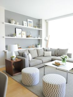 So pretty. Love the grey behind the wall to wall shelves.