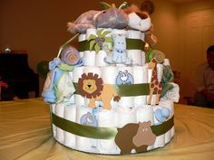 diaper cakes make great baby shower gifts how to make your own zoo animal baby shower invitation colorful monkey giraffe lion Idee Baby Shower, Funny Baby Shower Gifts, Mesas Para Baby Shower, Baby Shower Diapers, Baby Shower Cakes, Baby Shower Themes, Baby Boy Shower, Shower Ideas, Baby Gifts