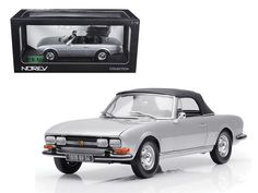 1971 Peugeot 504 Cabriolet Grey 1/18 Diecast Car Model by Norev - Brand new 1:18 scale diecast car model of 1971 Peugeot 504 Cabriolet Grey die cast car by Norev. Brand new box. Rubber tires. Has steerable wheels. Has opening hood, doors and trunk. Made of diecast with some plastic parts. Detailed interior, exterior, engine compartment. Dimensions approximately L-10, W-4, H-3.5 inches.-Weight: 4. Height: 8. Width: 15. Box Weight: 4. Box Width: 15. Box Height: 8. Box Depth: 7