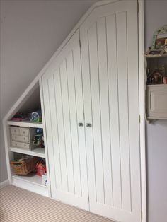 An angled ceiling bi-fold wardrobe and shelves we made and fitted recently. The doors are made from MDF with groove panels and have a hand painted finish. Staircase Storage, Closet Bedroom, Bedroom Design, Bedroom Loft, Attic Bedroom Ideas Angled Ceilings, Interior Design Bedroom, Bedroom Built In Wardrobe, Closet Design, Wardrobe Doors