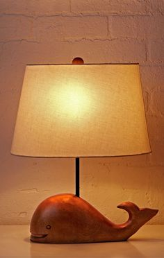 White whales are really rare. But even rarer are whale lamps. Only one of them has smooth wooden construction and a neutral cotton lamp shade. We're pretty sure it's the latter.