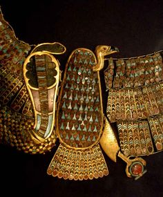 Flexible collar of Nebti, combination of Nekhebet and Buto (vulture and winged serpent) with superb workmanship. Made up of 171 gold plaques inlaid with polychrome glass and threaded together with borders of tiny beads.  Each plaque has a tiny eyelet at its top and bottom and these were threaded together to make the whole piece 'whole'.   Tutankhamun's Death Mask and funerary goods.Cairo Museum, Egypt.