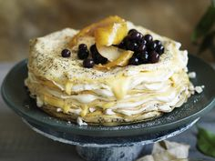 Poppy seeds add a delicious pop to this creamy, elegant lemon curd crepe cake topped with vanilla blueberries. Serve this for your loved ones on a special occasion.
