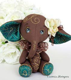 Animais de brinquedo, feitos à mão.  Mestres Fair - handmade elefante Chocolate.  Handmade.