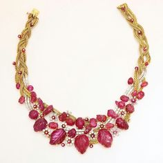 This spectacular Marchak yellow gold and platinum necklace is set with Burmese rubies interspersed with ruby beads and diamond clusters and accented by an undulating diamond ribbon with a double row of baguette diamonds.  More impressive estate jewelry in our September issue!  #diamonds #rubies #necklace #burmeseruby