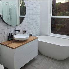 White wall mounted vanity with timber top, round white basin, chrome tap and mix. - Ikea DIY - The best IKEA hacks all in one place Ikea Vanity, White Vanity Bathroom, Wood Bathroom, Bathroom Renos, Laundry In Bathroom, Bathroom Wall Decor, Bathroom Ideas, Ikea Bathroom, Downstairs Bathroom