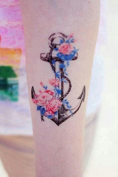 I like this anchor...  Not necessarily the flowers on it, but the shape & detail of the anchor itself.