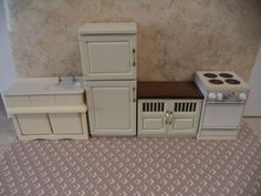 Fridge is 6 1/8 tall X 2 5/8 wide X 2 deep the cabinet is 2 3/4 tall X 3 3/8 wide X 2 deep ( these 2 pieces are new. The stove and sink are