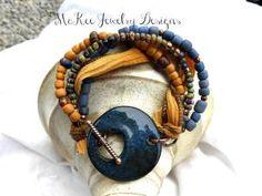 Ceramic, Czech glass, Indonesian glass and copper metal Multi strand bracelet. McKee Jewelry Designs by harriett