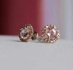 champagne peach sapphire diamond earrings. 14k rose gold.  not a fan of diamons, but still quite beautiful.