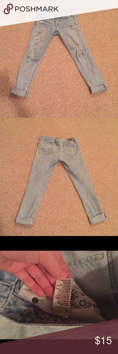 Extremely Distressed Skinny Jeans These jeans are extremely in style right now. They are in good condition. There is distress around the rips and the rips themselves. Please know this before you buy these :) American Eagle Outfitters Jeans Skinny