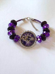 "Baltimore Ravens Football Inspired Beaded Purple Leather Adjustable Bracelet w Ravens Bird with White Lines Background 7 1/2""-9"" on Etsy, $20.00"