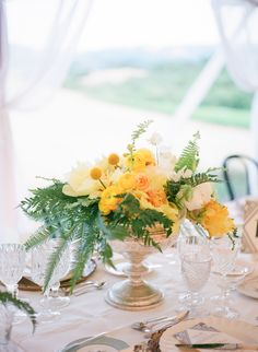 Yellow Wedding Centerpiece -- See more on #smp here: http://www.StyleMePretty.com/2014/04/16/great-gatsby-wedding-in-california/ Photography: ScottAndrewStudio.com