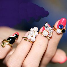 A set of 4 nail pearl rhinestone rings  at only $4.99