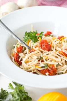 Gluten Free Quinoa Spaghetti with Roasted Tomatoes, Capers and Pine Nuts - A perfect weeknight meal!