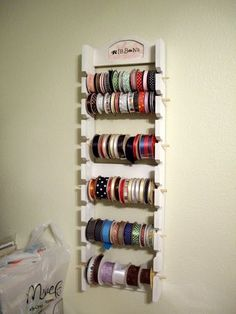 Ribbon holder!  This is even better than my idea of putting dowels inside a bookcase!