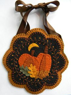 This pretty Autumn design can be made into a wall hanging, small table mat, mug rug, or maybe even a pincushion! The round version measures 7 and the scalloped version measures A quick and easy little project! The kit may be purchased at this shop. Fall Applique, Wool Applique Patterns, Quilt Patterns, Penny Rugs, Penny Rug Patterns, Canvas Patterns, Wool Wall Hanging, Wall Hangings, Felted Wool Crafts