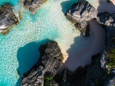 Visit the world-famous Horseshoe Bay in Bermuda. Rocky shores and coral sands surround the tranquil waters of this beach getaway.