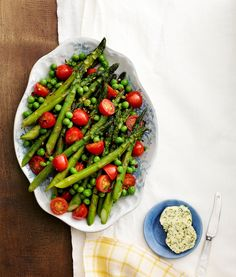 These garden-fresh asparagus, peas, and tomatoes are full of flavor. Sauteed lightly in olive oil and garlic then served with homemade herb butter, they're the perfect addition to any meal.