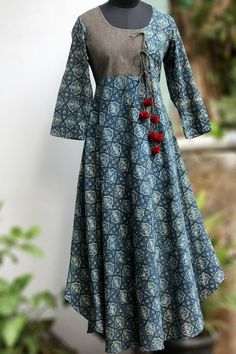 Buy Maati Crafts Blue Cotton Printed Anghrakha Kurti online in India at best price.a stunning evening dress, styled like a mughal inspired anghrakha with woollen fumdas at the end of dori. Salwar Designs, Blouse Designs, Pakistani Dresses, Indian Dresses, Indian Outfits, Kurta Patterns, Dress Patterns, Girl Fashion, Fashion Dresses
