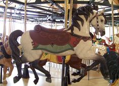 Davis Mercantile 1906 Dentzel Carousel (gears,center pole, etc.) with new wood carvings by Al Bontrager and painted by Cheryl Kellett.