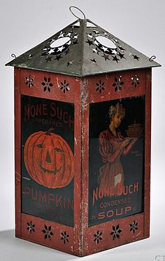 "Late 19th century ""None Such"" advertising tin lantern motion lamp, featuring condensed pumpkin pie package, minced meat and soup. Interior with candle-operated mechanical turning shade, bottom marked ""Patented Aug. 31st, 1897,"" (minor paint loss), ht. 16 in.   