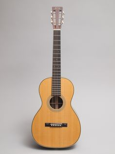 2012 Martin 0-28VS mint condition.  From Martin: The Martin 0-28VS Acoustic Guitar recreates a pre-World War II guitar that features a solid Sitka spruce top, solid East Indian rosewood back and sides, and a select hardwood modified V-shaped neck.