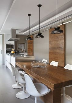 island + dining table. LOVE the wood!