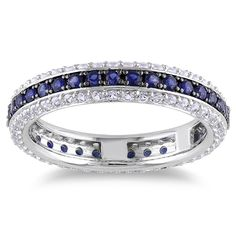 """<li>Eternity band features rows created blue, pink, black, or white sapphires </li> <li>Sterling silver jewelry</li> <li><a href=""""http://www.overstock.com/downloads/pdf/2010_RingSizing.pdf""""><span class=""""links"""">Click here for ring sizing guide</span></a>"""